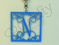 Single or Triple letter Monogram Keychains with an Ornate Border Style 1